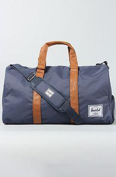 HERSCHEL SUPPLY The Novel Duffle Bag in Navy Tan. $64.00 at Karmaloop.com