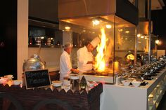 the live cooking station with Chef Ahmed Glass Restaurant, Restaurant Kitchen Design, Cooking Restaurant, Bistro Kitchen, Restaurant Interior Design, Glass Kitchen, Bar Interior, Cafe Restaurant, Commercial Kitchen