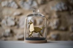 ~ This hand-folded origami unicorn is made of metallic gold paper. It is put on a handmade wood base and preciously kept in a glass bell. ~  This creation is 100% original and 100% handmade, except the bell. Ive entirely designed this decorative object. Ive folded the origami myself. Ive also designed and made the wood base in a Parisian wood workshop. >> height: 17 cm / 6.7 , diameter: 10 cm / 4 , weight : 450 g >> mix of hand-folded (origami) and cut paper >> metallic gold silk paper…