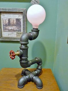 Black iron pipe lamp with FAUCET DIMMER handle by TeslaLamps, $160.00