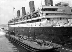 RMS Aquitania fueling at the port of New York, 1930.