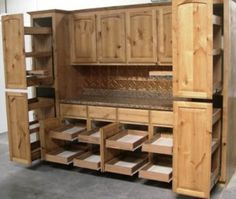 Pantry pull out shelves by slideoutshelvesllc.com with doors attached Knotty Alder Cabinets
