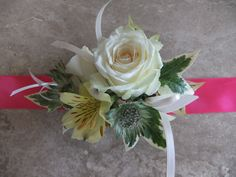 Rose and alstromeria wrist corsage with ribbon to match the wearers outfit
