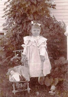 Vintage photo of sweet little girl with her doll.