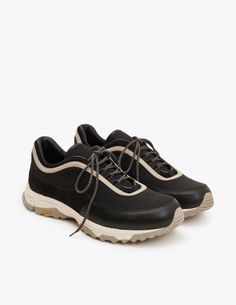 e35f29049eae1a Textile upper with a contrasting stripe. Suede and leather overlays.  Two-toned round laces through textile hoops. Leather lining and insole.
