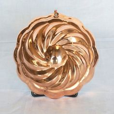 "This 6"" x 2"" copper swirl mold features a tin lining and a small hook that allows it to be wall mounted. Handcrafted in Istanbul, Turkey."