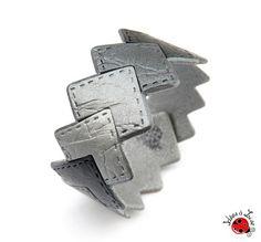 Bracelet graphique imitation cuir noir et gris