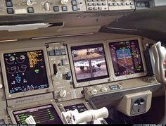 Flightdeck of the 777-300ER prototype; see the in-flight camera system on the MFD! At the 2003 Paris Air Salon.