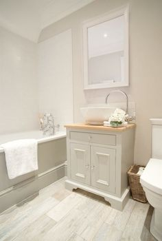 I like how light this is. would add darker faucet and maybe trim around the mirror. Also a little more to shower tile.