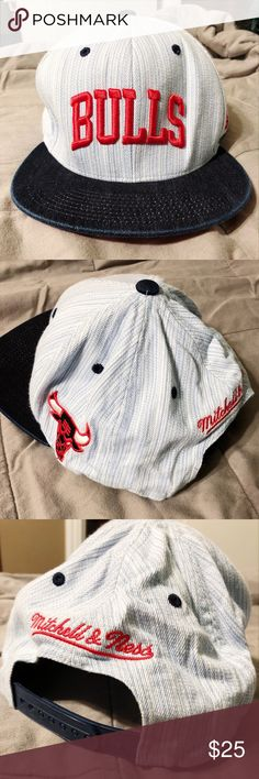 Mitchell & Ness Chicago Bulls Snapback Cap This is a gently wrinkled but NEVER WORN NWOT authentic vintage styled Chicago Bulls snap back cap hat. It's a gorgeous light blue striped over dark wash denim and red lettering to make a statement. The back cap is compressed a bit due to storage but otherwise no imperfections! Mitchell & Ness Accessories Hats