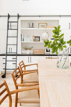 Dining Room with mid-century modern furniture and built-in cabinetry with library ladder, shiplap walls