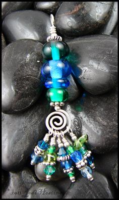 Beadworx Lampwork Glass and Sterling Silver Tassel by BeadworxAZ. $44.00, via Etsy.