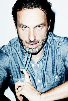 Andrew Lincoln...much more attractive with his english accent! ;)