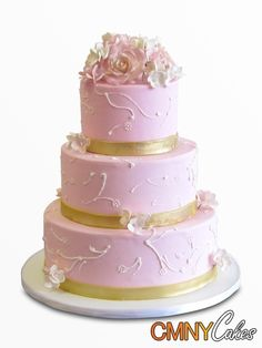 Pink Wedding Cake With Gold Ribbon