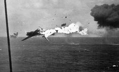 The USS Yorktown ensures this Japanese bomber does not inflict the same kind of kamikaze damage as was suffered by the Essex. Kamikaze Pilots, Us Bombers, Uss Yorktown, Bail Out, Naval History, Japanese Film, Aircraft Photos, Submarines, Aircraft Carrier
