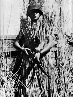 A camouflaged German soldier and his 8mm Mauser K98.