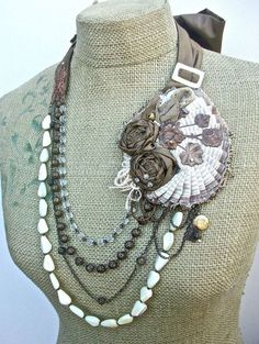Tumbleweed- tie necklace\/ earring set with shabby fabric assembled feature Vintage bronze stampings Vintage MOP beads and seed pearls. $135.00 via Etsy.