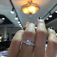 This absolutely stunning, romantic Gabriel & Co. ER4020W44JJ White Gold Three Stone Princess Cut Engagement Ring Setting is effortless with its beauty.