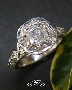 antique style engagement ring with her .88ct asscher cut center diamond and 46 melee diamonds - See more at: http://www.greenlakejewelry.com/gallery/cust_gallery.aspx?ImageID=%2064747#sthash.lEIxakAp.dpuf