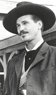 "Val Kilmer portraying John Henry ""Doc"" Holliday"