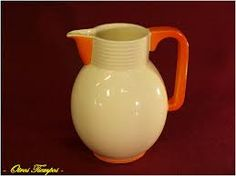 WAECHTERSBACH ART DECO: ORANGE CERAMIC PITCHER . @Deidré Wallace