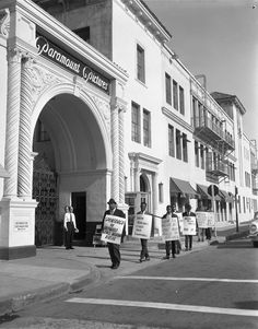 "Protest at Paramount Pictures, 1962. This protest, sponsored by the Hollywood Race Relations Bureau, features signs that read, ""Show Africans other than cannibals;"" ""Show the Negro as part and parcel of America;"" and ""Motion Picture Industries wake up.""  Harry Adams Collection.   Institute for Arts and Media Photographs."