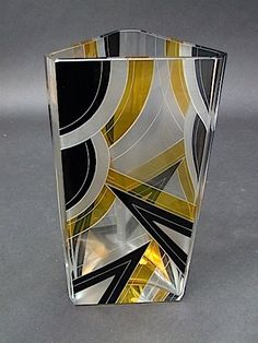 Large Three Sided Vase by Palda  Heavy glass vase with black and yellow enamelling detail of irregular shape as it is 3 sided. It measures approx. 10 inches high by 5.5 wide to each panel (25.5cm x 14). Condition is excellent.   Ref: G555 . . . £675