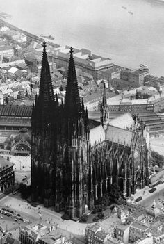 Photo of the Cologne Cathedral in Germany, from the 1930s. The cathedral is the most visited site for tourists in Germany and claims to  be the burial site of the Three Wise Men.  The cornerstone for the very old, very large structure was laid in 1248. #HighMiddleAges #Cathedrals