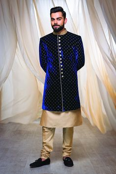 What fun are winter weddings when we stay up late in the chilling outdoor gardens, singing along with friends and relatives around an angithi. But if you&rs. Sherwani For Men Wedding, Wedding Dresses Men Indian, Wedding Dress Men, Wedding Suits, Wedding Groom, Sherwani Groom, Mens Sherwani, Bride Groom, Engagement Dress For Groom