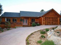 2016 Linden Drive, Pine Mountain Club, CA 93222 — Nothing left to chance in this OUTSTANDING custom built home.3 BR 2Ba, Over sized Garage with U shaped drive, 478 SF sun room, and 830 SF of wood decks ALL ON ONE LEVEL.  The house is clad in cedar T & G with a cedar garage door. High quality carpet, fiber flooring and 9' ceilings throughout.  CAT 5 wiring in each room. Forced air heating and air conditioning.  Myrtle hardwood flooring.  Family room is presently decorated as an English Pub…