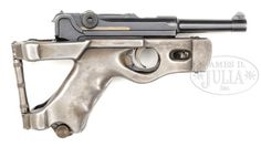 Luger 1920 pistol with rare Benke & Thiemann folding stock Manufactured by Deutsches Waffen Und Munitionsfabriken. 7,65x21mm/.30 Luger, pistol SN is 3866, stock SN is 31. The stock, once folded up around the pistol, still allowed it to be fired and holstered, with the added benefit of looking rad as fuck. Sauce : James D. Julia Inc.