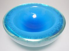 This stunning and heavy Mid Century Murano Alfredo Barbini geode bowl is triple cased with clear, white and blue glass with graduated Bullicante bubbles throughout. The blue glass starts light and then deepens into the bowl bottom.  Bowl measures 6 inches in diameter and stands 2 5/8 inches tall. Would make an excellent Caviar dish, displays very nicely. Base is cut and polished. Excellent undamaged condition.  Bowl will be well packed & shipped quickly. Shipping weight is 4 lbs.  Th...
