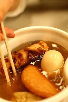 Oden is a Japanese winter dish consisting of several ingredients such as boiled eggs, daikon radish, konnyaku, and processed fish cakes stewed in a light, soy-flavoured dashi broth. Ingredients vary according to region and between each household. Karashi (Japanese mustard) is often used as a condiment.