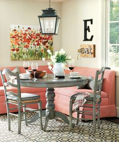 a coral banquette seat plays off the cheery reds in our sea of poppies print in - Kitchen Booth Seating