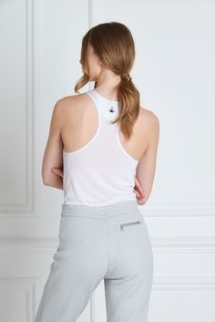 Gaia Sweatpants - A flattering look for travel or lounging can finally be found in the Gaia Sweatpants. Smart and tailored with drawstring closure, tapered ankles and high quality zippered pockets. These ultra luxe tracksuit pants are made of a quilted, non-toxic material, lined with soft jersey and finished with a reverse side logo.