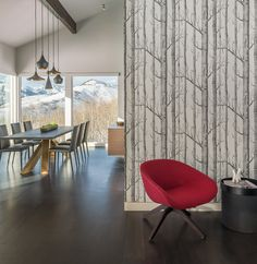 """The clients, a couple who resides full-time in San Francisco, desired a new modern vacation home in Jackson Hole. Views were the determining factor in their selecting a house located on a butte overlooking the valley and adjacent mountain ranges. Built in 1992, this house was considered """"contemporary"""" for its time"""