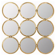 Nine iron-framed circles form this contemporary mirror. Features an…
