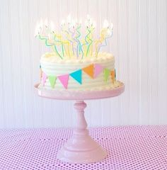 Cute birthday cake with twisty candles. #party #birthdaycake #decorating #celebration #desserts #sweets #treats