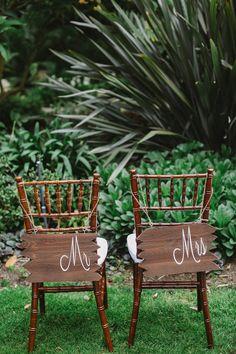 reception chair backs, photo by Allie Lindsey Photography http://ruffledblog.com/san-diego-botanic-garden-wedding #weddingideas #woodsigns