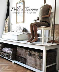 Vintage Interior - love the vintage baskets under that table.