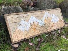 This mountain range wood patterned wall art is made with pine stained different colors to give it a rustic reclaimed wood look. This is a perfect piece for any outdoors lovers! It has five mountains all stained different shades of browns with white distressed mountain tops and a grey stained sky. It measures 47x20 and it comes with a preinstalled wire for hanging.  **NOTE - This piece is made to order. The picture displayed is the template and will be the same design but may have different…