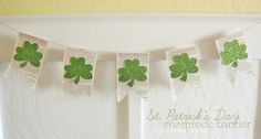 Shamrock Banner by Lolly Jane.  A great way to make glittered cardstock pop is to back it to a neutral color, like the book pages on this enchanting banner.  Try American Craft's Glitter Cardstock sold at www.cardstockshop.com.