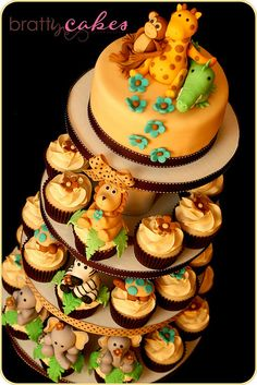 Safari baby shower cake, this is so cute. But I also thought it would be cute to do a Noah's Ark Cake too. Love this idea, so maybe those who don't like fondant won't have to have fondant but some can have it if they like it Safari Baby Shower Cake, Baby Shower Cakes, Baby Boy Shower, Beautiful Cakes, Amazing Cakes, Beautiful Boys, Noahs Ark Cake, Party Deco, Safari Cakes