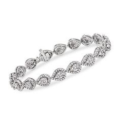 This 5.10 ct. t.w. diamond bracelet dazzles with an uninterrupted stream of…