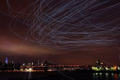 Pigeons wearing lights illuminate New York's night sky - Artist Duke Riley released 2,000 pigeons wearing LED lights into the night sky over Brooklyn and directed the birds with a flag and pole