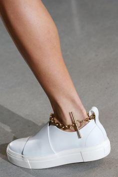 Clean white sneakers with an embellished gold ankle chain from the Spring 2016 Calvin Klein Collection