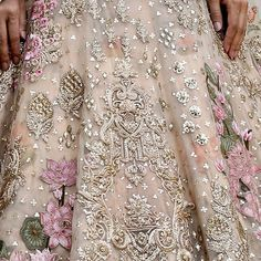A pale gold tulle and silk lehenga. The lehenga is wrought with fine resham, sequins and kasab zardozi, used in a painterly way to render… Pakistani Party Wear Dresses, Nikkah Dress, Desi Wedding Dresses, Pakistani Bridal Dresses, Pakistani Dress Design, Bridal Lehenga, Zardozi Embroidery, Couture Embroidery, Embroidery Fashion