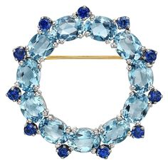 Aquamarine Sapphire Open Circle Brooch | From a unique collection of vintage brooches at https://www.1stdibs.com/jewelry/brooches/brooches/