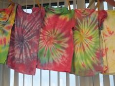 Tie dyed T-shirts by Tillicoultry Primary School Full instructions can be seen here: http://www.handprinted.net/instructions/Rainbow%20Tie%20Dye%20handprinted.pdf