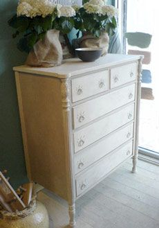 Annie Sloan chalk paint in Country Grey w/Old White drawers...thinking about doing this to my dresser which looks just like this one.